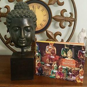 Buddha head and book
